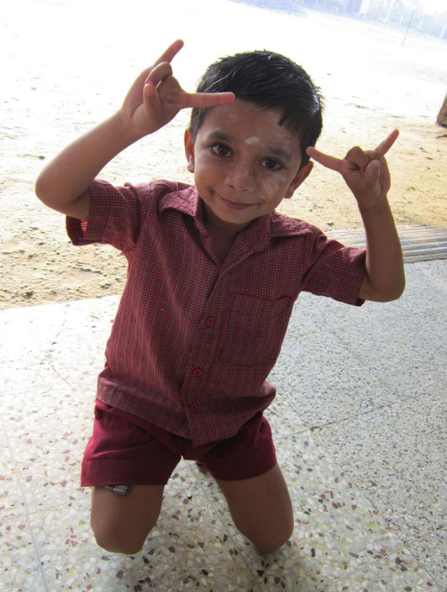 Little Seenu - is this the sign for 'I love you' or 'Hang Loose'?