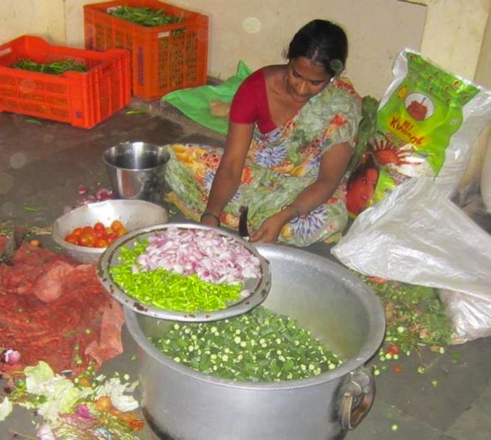 Manjula preparing vegetables.