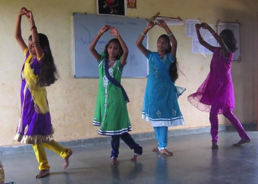 Girl dancing during the welcome program.