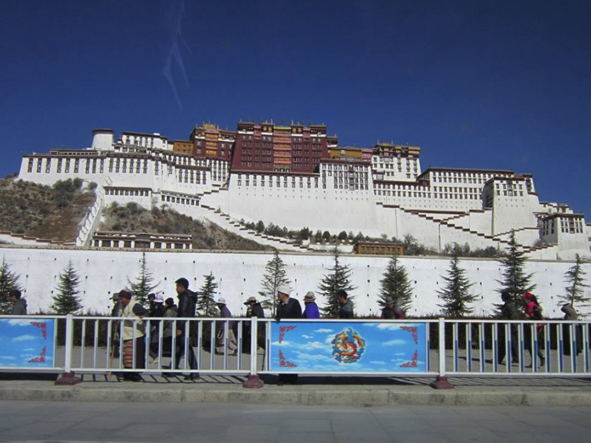 The Potala Palace. . In the foreground you can see pilgrims circling it as well.