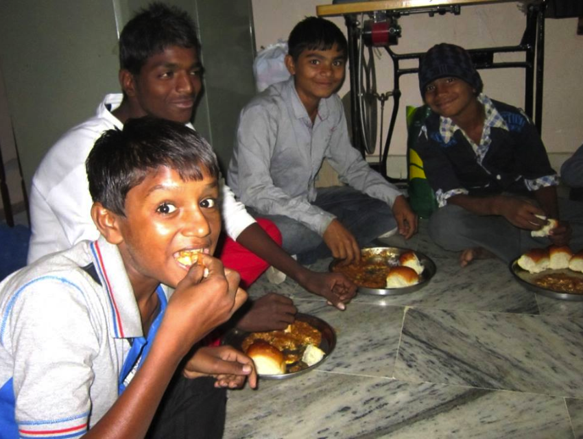 Some of the boys enjoying pav bhaji, kind of like a vegetarian sloppy joes, a Home favorite.