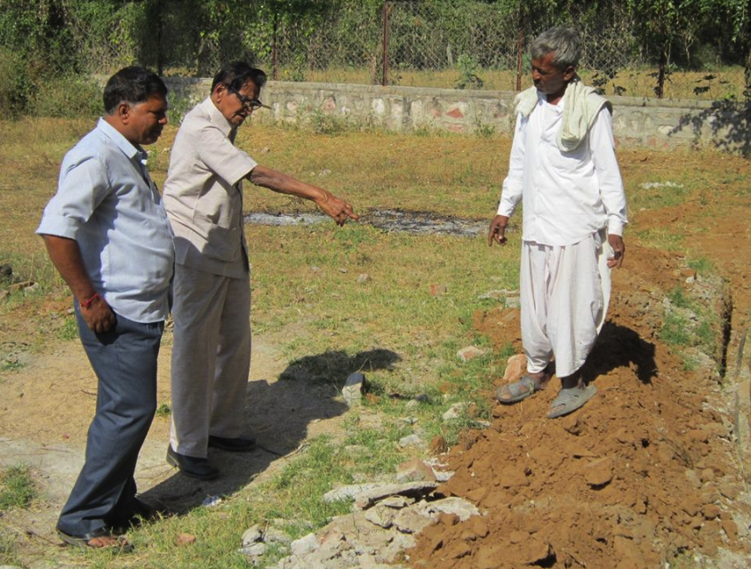 Dr. Mapuskar in the middle of pointing out the layout of the biogas plant. I have only seen the Doctor wearing khaki, the homespun clothing inspired by Gandhi.