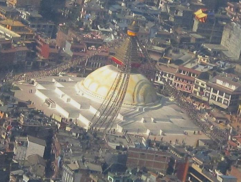 Boudhanath, the ancient Buddhist Stupa, which pilgrims circle performing their Kora much as is done around the temples of Lhasa.