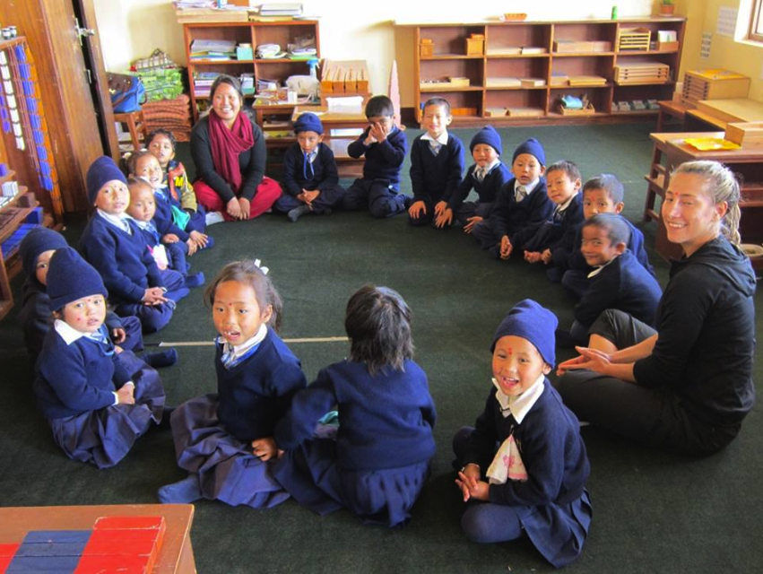 Shoba, in the red scarf, with her class. Volunteer Intern, Jenna, from New Jersey, has been helping with the class during her 3 month stay.